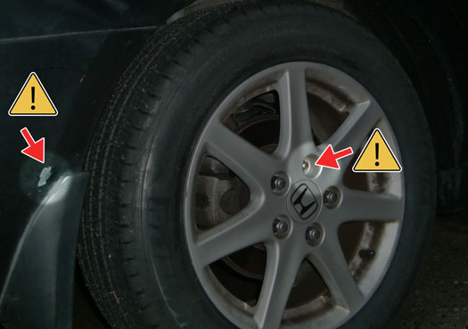Chipped paint and missing locking lug nut
