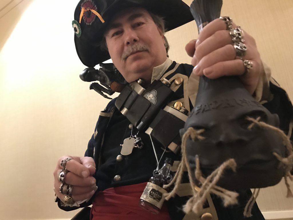 Captain Rumpot with a bottle of Deadhead Rum